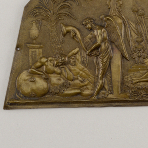 Polygon with straight lower edge, with repoussé decoration showing classical scene with a recumbent nude on a couch.
