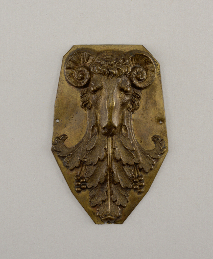 Ram's head with acanthus leaves. Two holes for mounting.