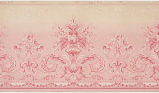 This frieze features a horizontal repeat of alternating large and small floral arrangements supported by bows and acanthus scrollwork. A small festoon of leaves and a solid stripe borders the bottom edge of the panel, and a small festoon of blossoms and bows hangs below a stripe on the top edge. The design is printed in shades of pink and white, and the background is shaded, fading from pink into beige from the bottom to top of the panel.