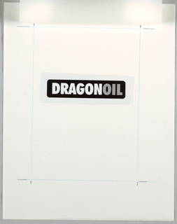 Design for a logo. The word DRAGONOIL, reproduced on self adhesive photographic film, mounted at center of sheet. The word dragon in white; oil in gray dot-screen pattern. Blue ruled lines define borders; two black registration marks at each corner. Tracing paper overlay attached to wove mounting paper with white tape at top edge.