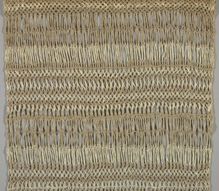 Vertically rectangular hanging with alternating rows of light and dark threads, knitted with dense and open stitches, with a wooden dowel at the top for hanging.
