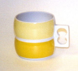 Cylindrical body formed of two convex sections, one above and the other, white pierced rectangular handle on side; white body, exterior of top section glazed in light yellow, bottom section in yellow.