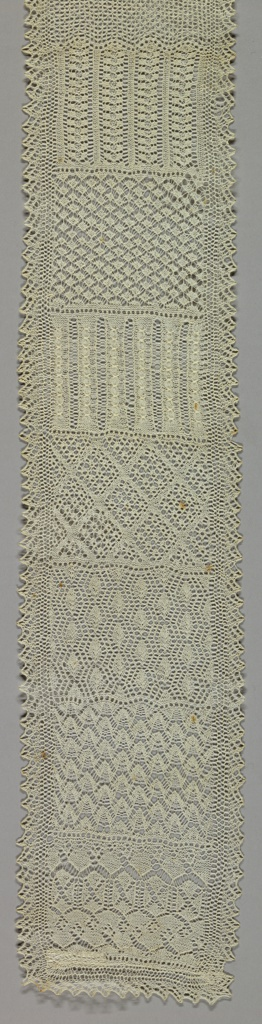 Long narrow sampler of knitting in fine linen, showing twenty-five sections of different stitches, narrow end designs.