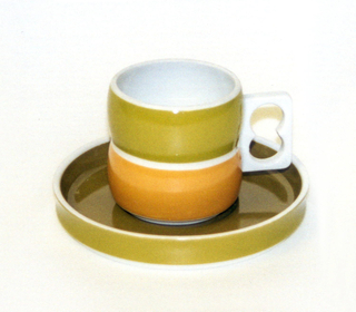 Cup (a): cylindrical white body formed of two convex sections, one above the other, white pierced rectangular handle on side; exterior of top section glazed in light green, bottom section in orange. Saucer (b): circular form with slightly concave upright rim; white body glazed green on interior, light green on exterior rim.