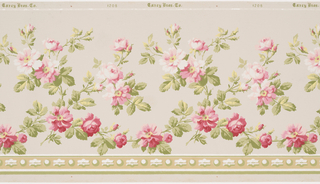 A realistically rendered vine of pink roses meanders horizontally across the panel. The bottom of the panel is bordered by a stripe of alternating spheres and curvilinear dashes. This pattern is printed in shades of green, yellow, pink, white and tan on a beige background.