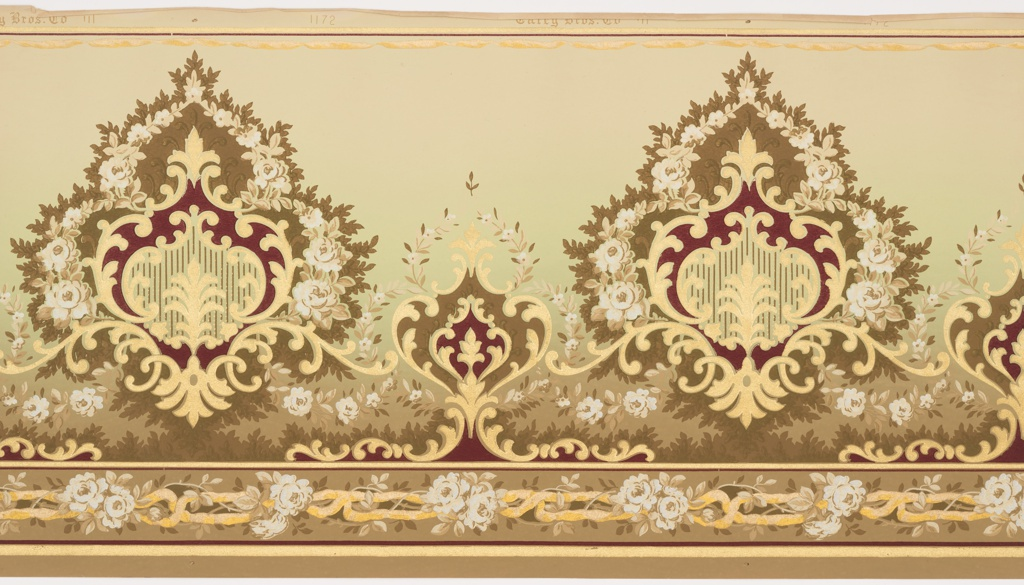 large-scale floral medallion alternating with smaller medallion. Band of twistted ribbon runs along bottom edge. Printed in deep red, white and metallic gold tan background that shades to green in middle and brown near the bottom.