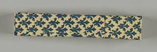 Cardboard box covered with paper showing blue fleur-de-lys. Removable lid.