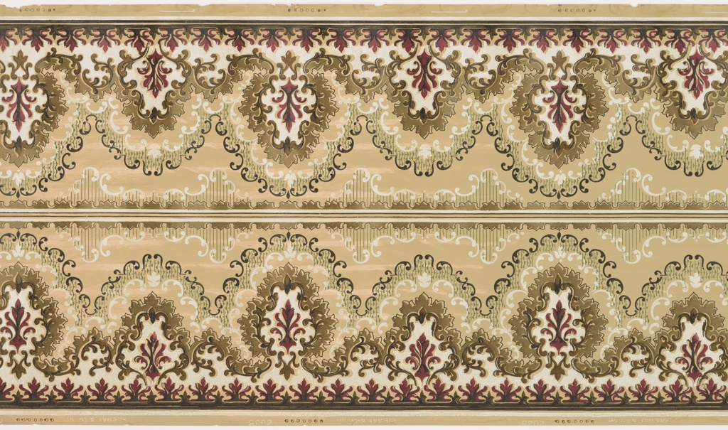 Two bands of mirror-reversed repeating design composed of a continuous frieze of alternating large and smaller foliate cameos on a solid ground, with occasional horizontal bands bordered on the top by a complementary foliate frieze and on the bottom by horizontal stripes. Printed in white, black, umbre, scarlet, green, peach and pale olive green.