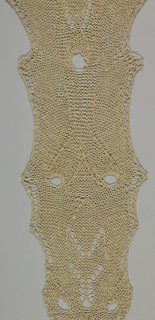 Long, symmetrical knitted hanging in natural linen.