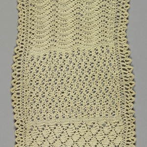 Narrow knitting sampler showing bands of different patterns.