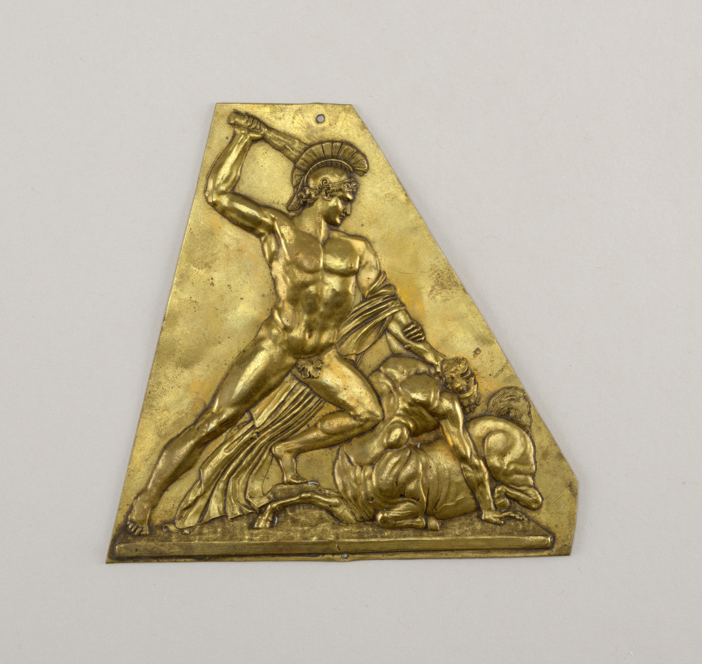 Irregular triangle with repoussé nude with helmet raising a club over a kneeling centaur. Possibly representing Herakles and Nessus.