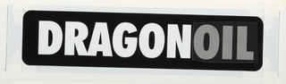 Design for logo. The word DRAGONOIL in black and white with dot-screen presure sensitive tape over the word oil, producing a dark gray tone. The word dragon is in white. The  thick, san-serif block capital letters are placed on rectangle in center of sheet.The assembled papers are tightly taped to the backing paper with white tape. Thecorners are rounded with white paint. tracing paper overlay secured with white adhesive paper tape.