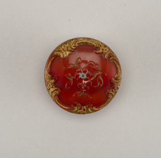 reddish-brown buttons ornamented by small floral spray within scrolling border - double shank of brass.