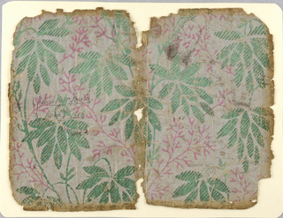Large pattern of leaf clusters in green, overprinted with diagonal cross-strokes in darker green; secondary pattern of pink vine-form. Backed with paper of same design. The paper is light brown, of coarse texture. Formerly used as a book cover.