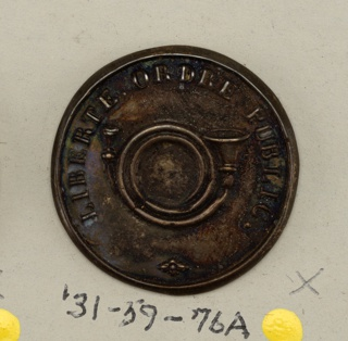 "Circular flat buttons ornamented with a horn and the words ""Liberte Ordre Public"". Massures.