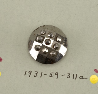 circular, convex buttons ornamented with nine small facetted knobs.