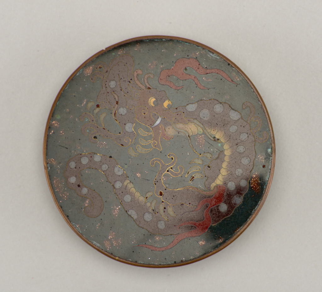 Enameled button with dragon