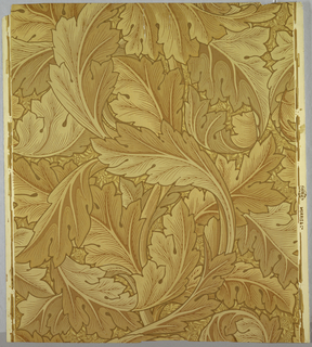 "A design composed entirely of acanthus leaves drawn on a large scale in a continuous scroll repeat showing intricacy of form and line. The design shows a Gothic influence. ""Morris & Co."" is printed in selvedge. Printed in tans, gold and brown."
