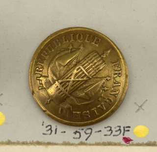 "convex buttons with ornament showing facses with spear placed on crossed flags and the words ""Republique francaise.""  Component ""f"" is found on card 57"