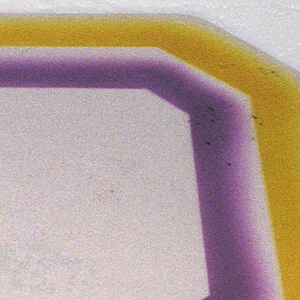 Rectangular tray with stepped feet at corners. Pink and green rectangular glaze on white ground.