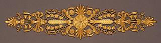 Lotus rosette surrounded by palmette motifs.