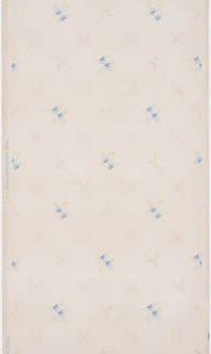 On light gray ground, trellis like pattern with two alternating motifs: blue floral clusters and cross-like in pink.