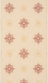 Yellow ocher quatrefoil motifs connected by white scrolling foliage creating a trellis pattern. Lacey red motifs fill each of the voids created by the trellis framework. Printed on a tan ground.