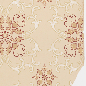 On taupe ground, scroll motifs composed of brown scrolls in circular shape outlined in red, red dots, an surrounded by white scrolls outlined in light green brown; smaller brown floral motifs with red dots and outlined in red in spaces.