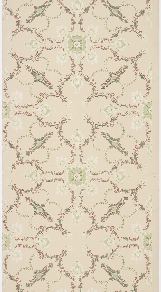 On light green-gray ground, scroll treillage in green outlined in red, with white and green square motif at center and small acanthus leaves.