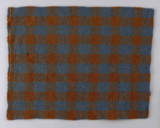 Blue and brown gingham check (formed when alternating blue and brown stripes in both the warp and weft intersect to give solid blue, solid brown, and a blue/brown mixed shade.)
