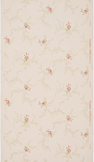 Dark pink flowers are repeated in a diagonal pattern throughout the sidewall. Each flower has light pink and green meandering sprigs. The flower bunches alternate in position and repeat every other register. Printed on a light pink ground.