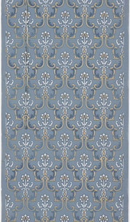 Very dense pattern of foliate medallions. The medallions form a fish-scale or diaper design. Printed in blue, white and metallic gold on blue ground.