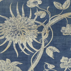 Length of printed cotton with a naturalistic design with nasturtiums, passion flower, and other flowers, foliage, and vines crossing and intertwining. The design appears in white on a rich indigo blue ground with etched details in blue.