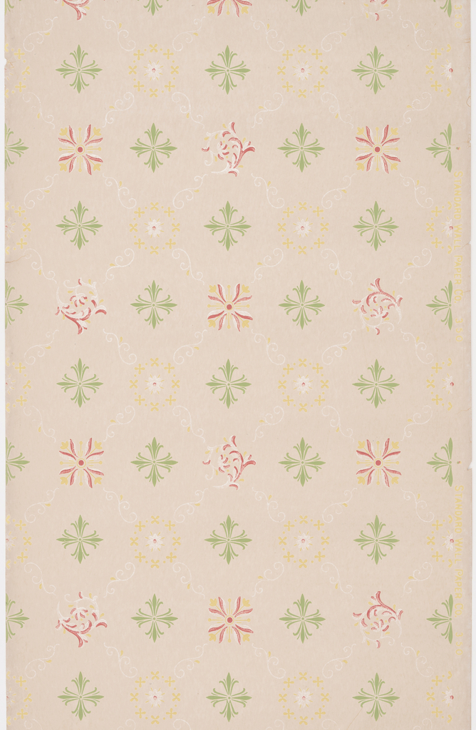 Pattern containing four different motifs with every second motif linked together for foliate scrolls forming a trellis pattern. Printed in green, yellow, and white mica on a tan ground.