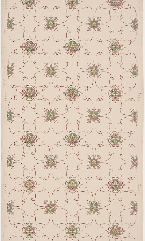 Two different squarish motifs alternating in rows. Connected by dotted scrolling lines. Printed on tan ground.