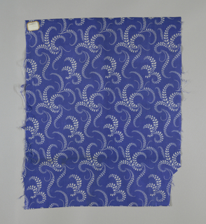 Royal blue silk with a meandering floral pattern in white.