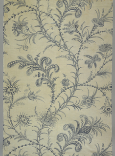 Length of printed cotton with a large scale design of curving bamboo-like stems with pineapples and feathers as foliage, in blue on a white ground.