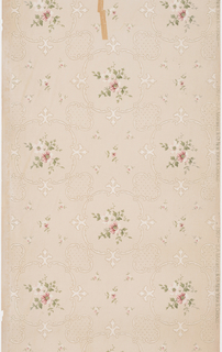 Delicate floral sprigs in pink and white with light green stems and leaves enframed within quatrefoil-like motif. The framing element contains four fleur-de-lis along with small flower motifs. These garland frames are connected to smaller garland frames that encase polka dot designs. In between the large and small frames are five pink and white flowers in a square formation, with one larger flower at the center. These flowers mimic the even larger flower bunches that are the focal point of the sidewall.