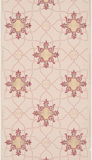 The central decorative motif is a gold double fleur-de-lis surrounded by red scrolls and foliage. S-shaped lines make up the web between the alternating registers. Smaller gold double fleur-de-lis motifs are connected to the central scrolling designs by the S-shaped lines. Printed with mica on a light pink ground.
