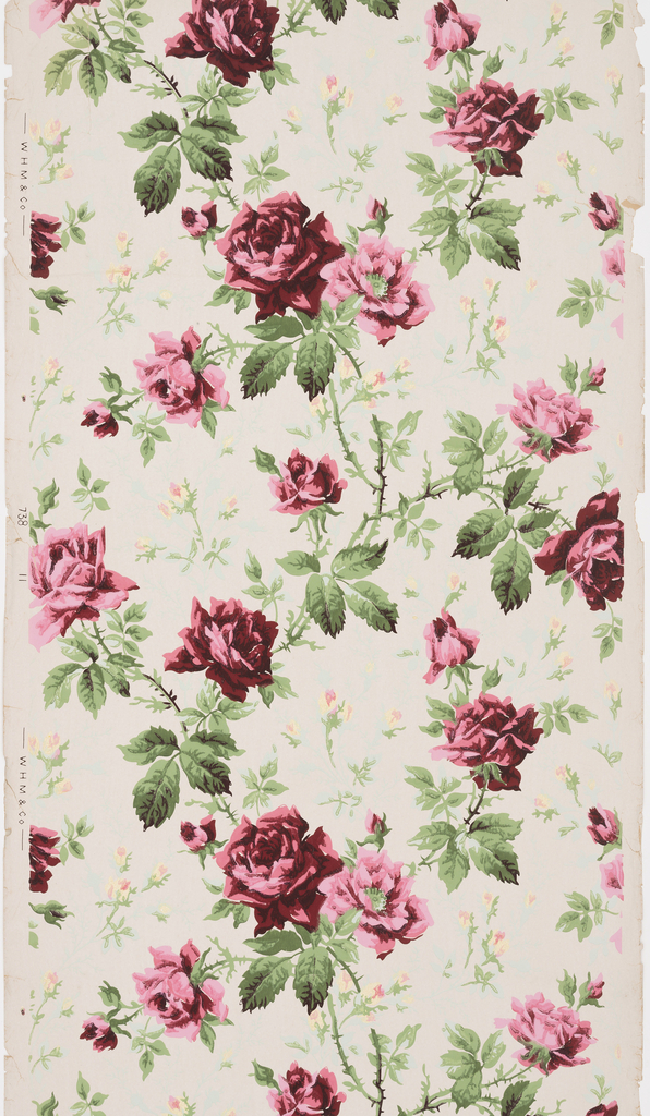 Design of red and pink roses on vining stems. Roses are shown in all stages of development from small buds to full blown flowers. Printed on off-white ground.
