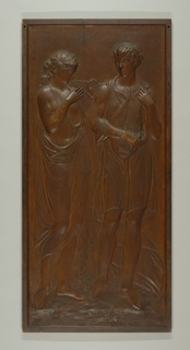 Two large, carved door panels. In one piece, with plain raised surround. Carved in low relief, each with two female figures in lightly draped classical costume. -a: shows woman with reed pipes and another with a lyre; -b: shows woman with tamborine, and another without a musical instrument.