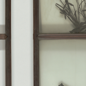 Teak panel in two sections, glass fronts, ground-glass backs.  Fret-scroll metal hanger.  Upper section:  Bamboo, main stem, with small shoots and leaves, all in wrought iron.  Lower section:  Orchids, two flowers, and a crcket, all in wrought iron.