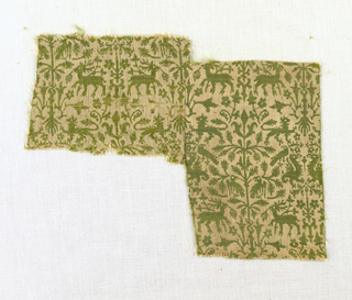 Closely spaced minute design of affronted animals and birds flanking symmetrical foliate arrangements in rose (faded) and green.