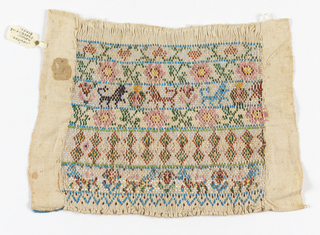 Sampler or cuff of smocking showing horizontal bands of embroidered multicolored beadwork with geometric patterning and animals on linen.