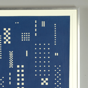 Pattern designed to resemble the lit windows of the New York skyline at night. White rectangluar groups of small squares placed against a dark blue background.