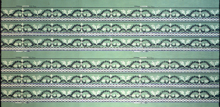 Narrow borders with foliate scrolls, printed in green and white on green ground. Printed six across.