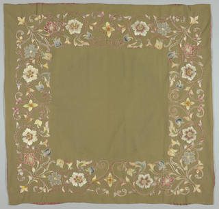 Table cover of olive-drab woolen cloth embroidered in color silks in design of scrolling stems with flowers; lined with pink silk satin.