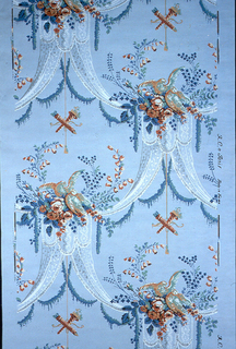 Drapery pattern with valance, floral bouquet and perched bird atop, with crossed torches suspended from center. Printed in colors on blue ground.