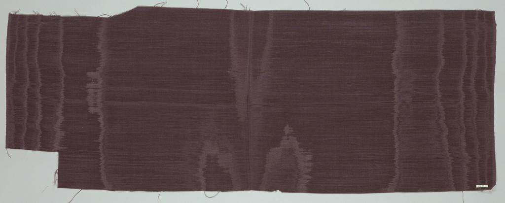 Length of heavily ribbed, dark purple-gray moiré fabric.