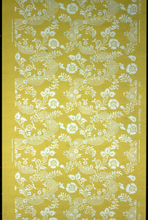 All-over vining floral pattern, the stems having a very lacey effect. Printed in white on a yellow ground.